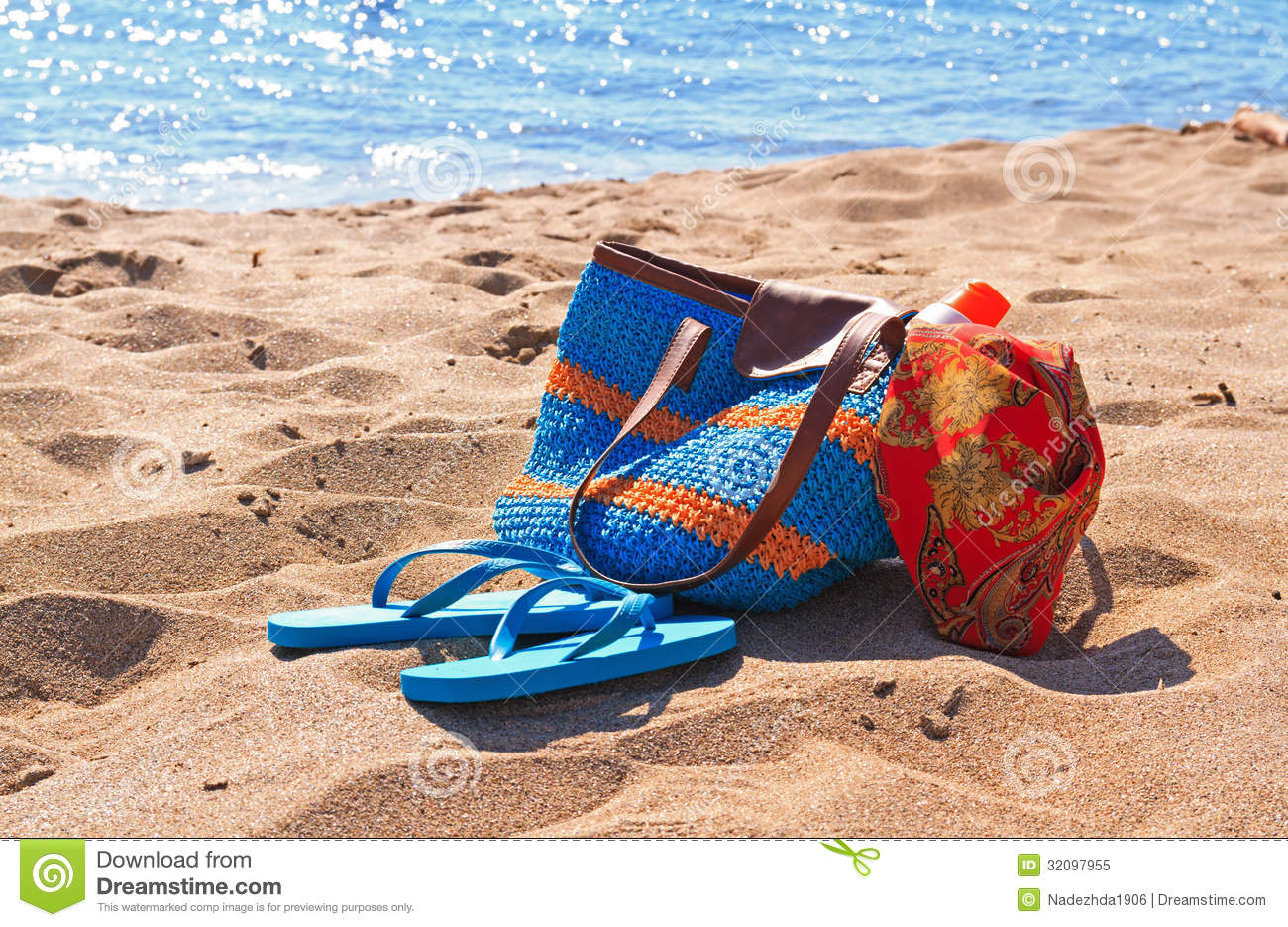 Beach Bag And Flip Flops On The Beach Royalty Free Stock Photo ...
