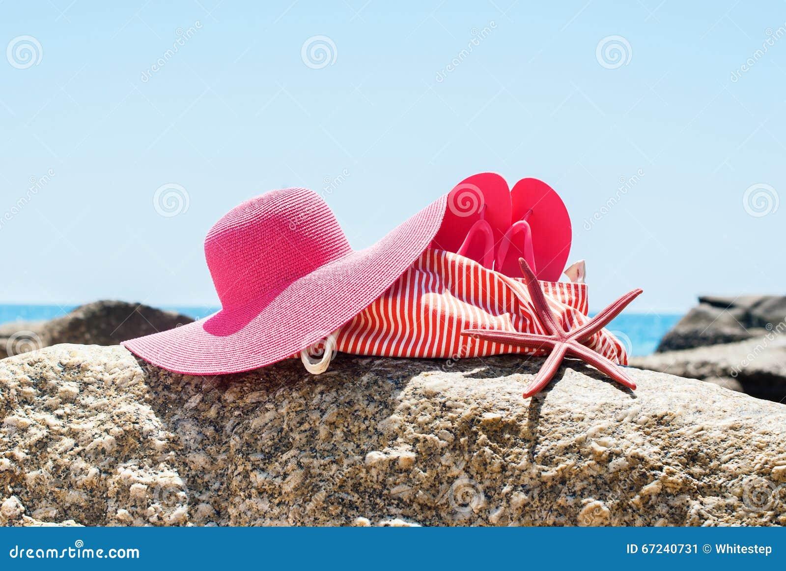 60e9755fb119c Beach Bag Flip Flops Sea Star Hat Stones Overlooking Ocean Summer Holiday  Concept