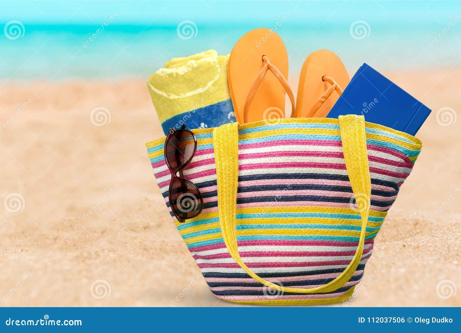 4eaf5e658 Beach Bag On Sand Of Tropical Beach Stock Photo - Image of towel ...