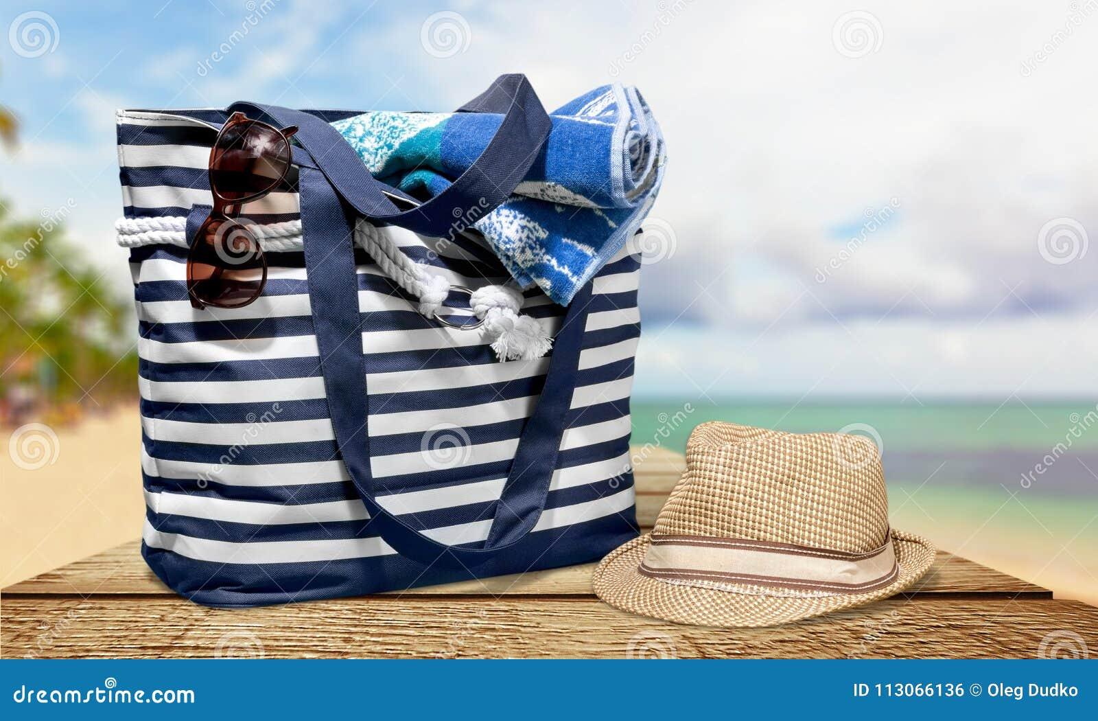 03ab60fb6 Beach Bag On Sand Of Tropical Beach Stock Photo - Image of isolated ...