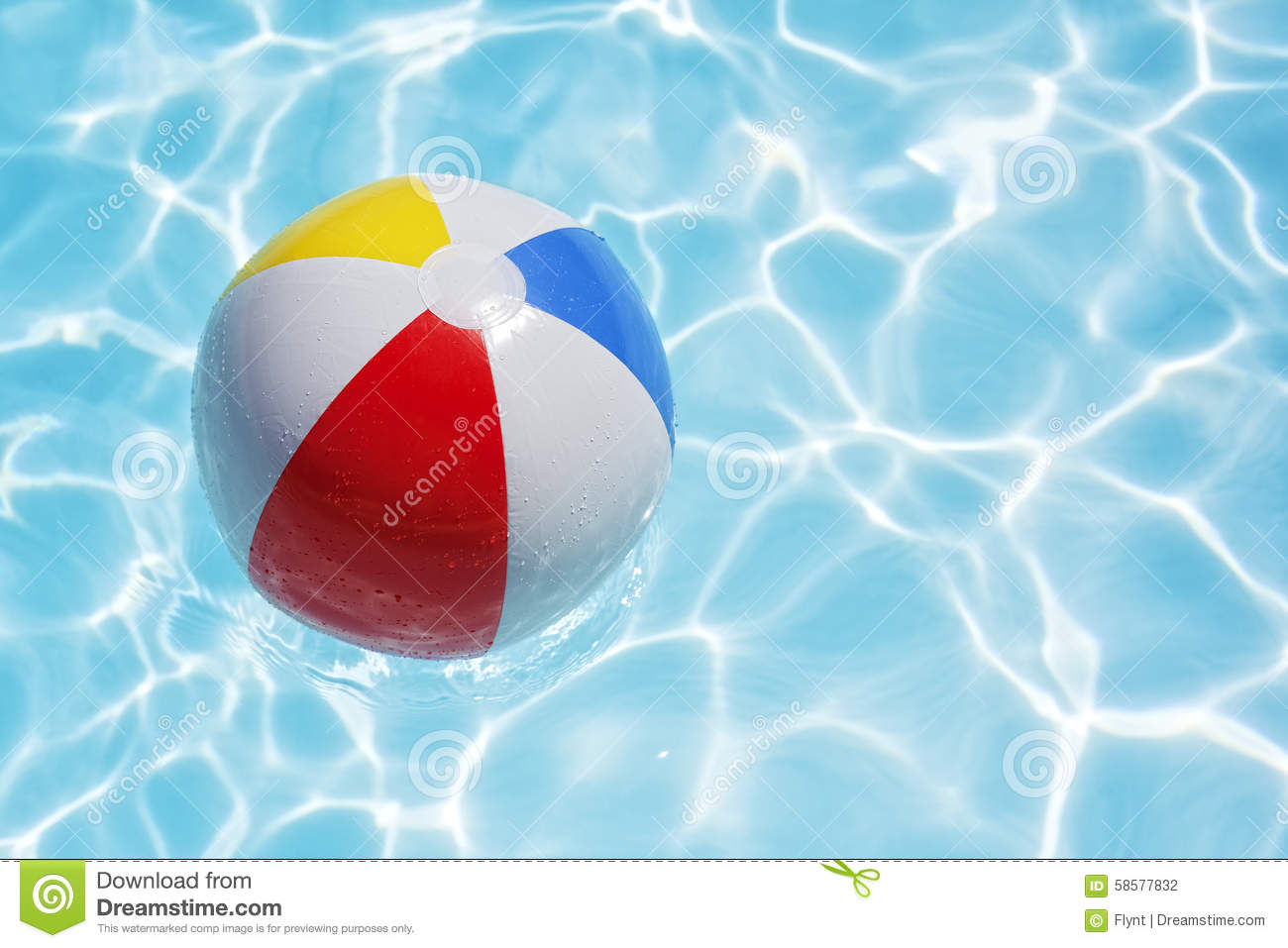 Beach Ball Floating In Swimming Pool Abstract Concept For Summer