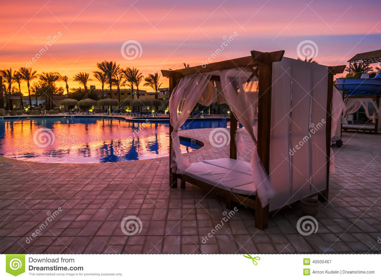 Beach bed with canopy by the pool on the beach stock photo for Pool canopy bed
