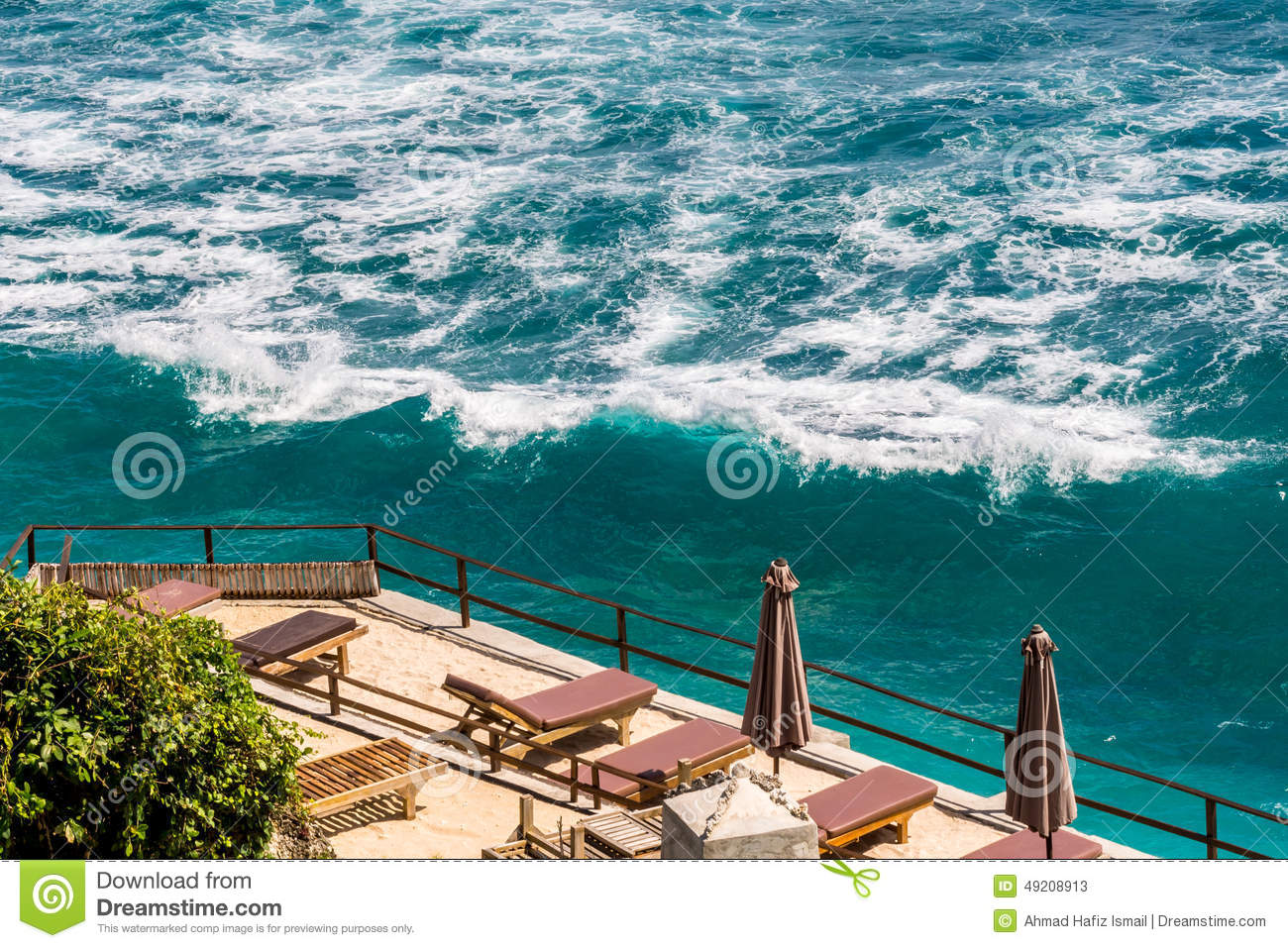 Stock photo beach chair facing the sea on high ground