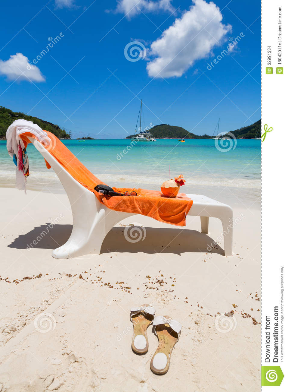 Beach chair with orange towel and coconut drink stock images image 32991334