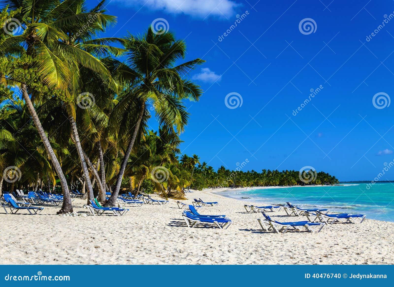 Caribbean Relaxation: Beach Chair On Sandy Caribbean Beach In Cuba Stock Photo