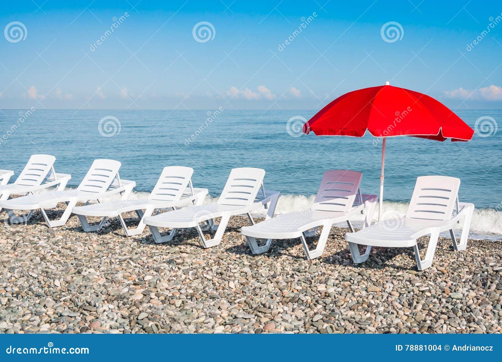Beach Chairs And Red Umbrella On Shingle Beach Stock Photo - Image ...