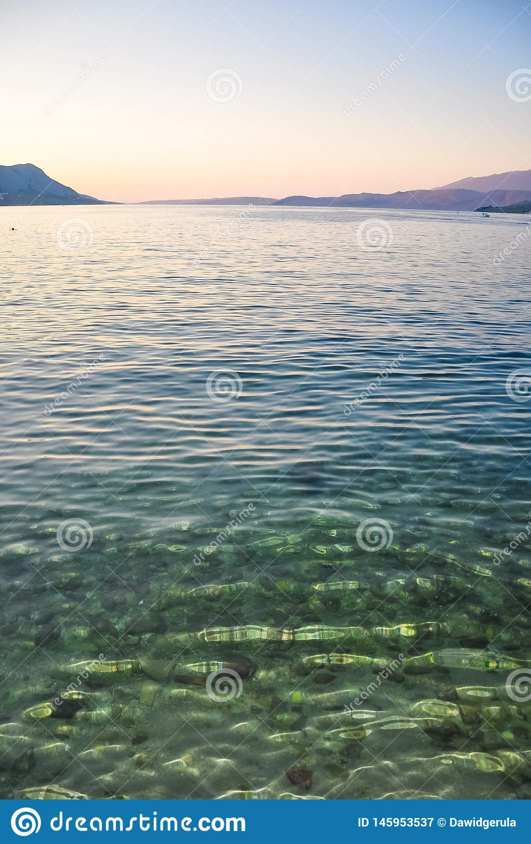 Crystal clear water in the coast of Adriatic Sea island Pag, Croatia after sunset
