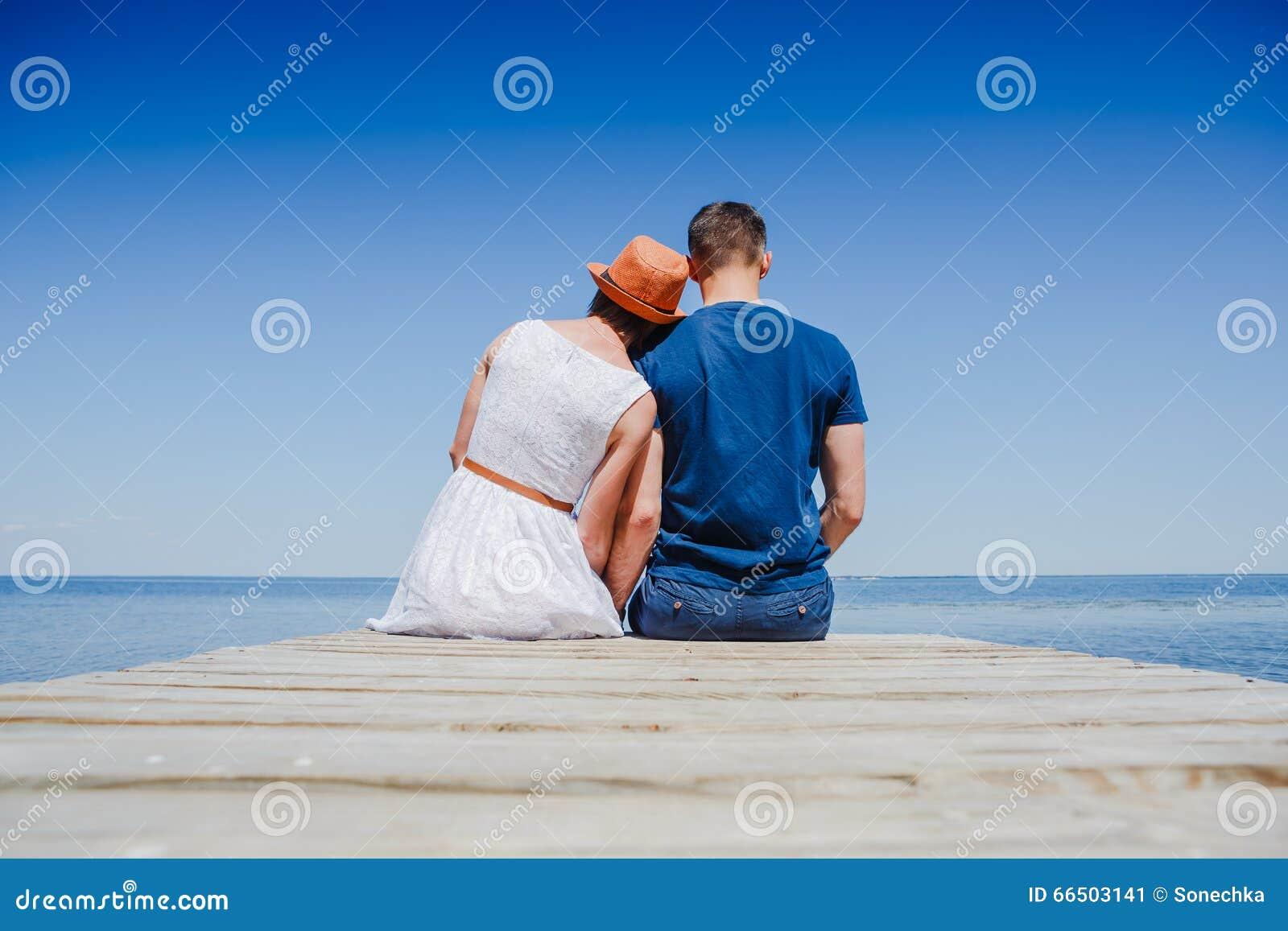 Beach couple enjoying fun romantic vacation holiday