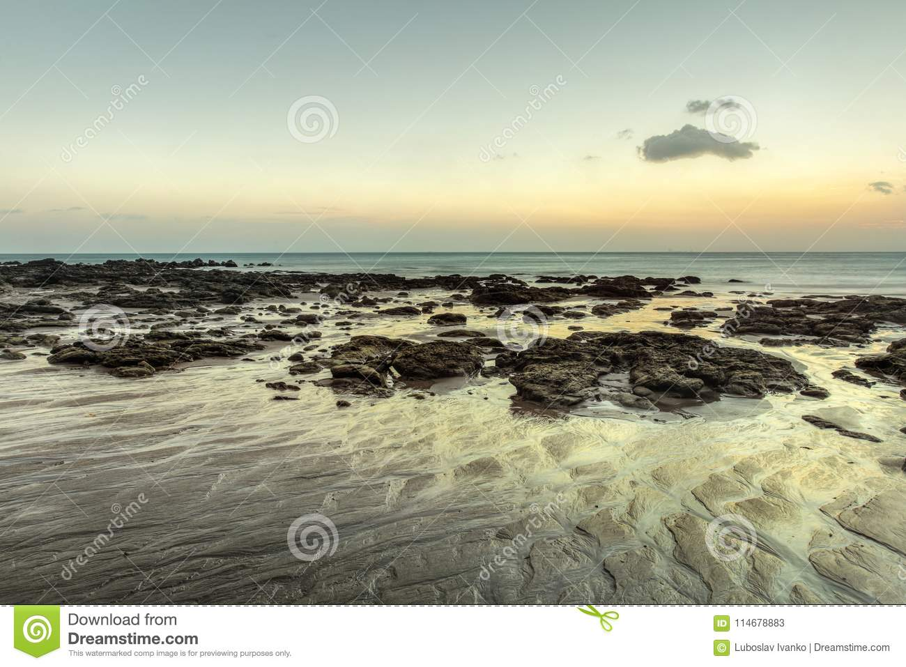 Beach in evening, after sunset during low tide showing sand form