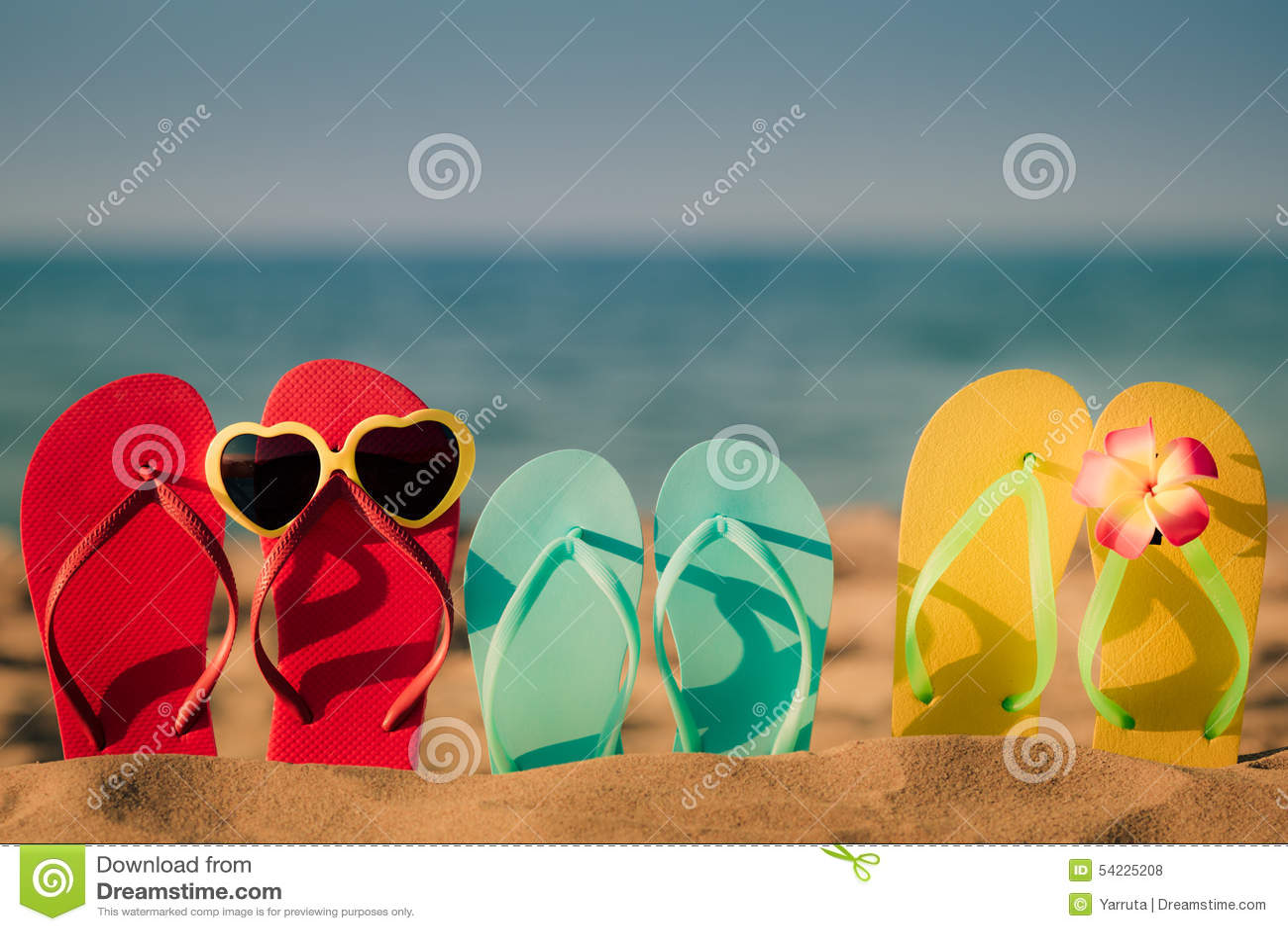 Beach flip-flops on the sand