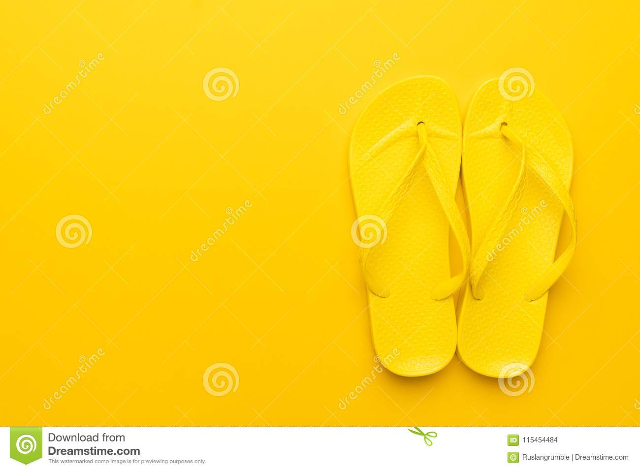 44c3e0a05e23 Beach flip-flops on the yellow background with copy space. summer is concept