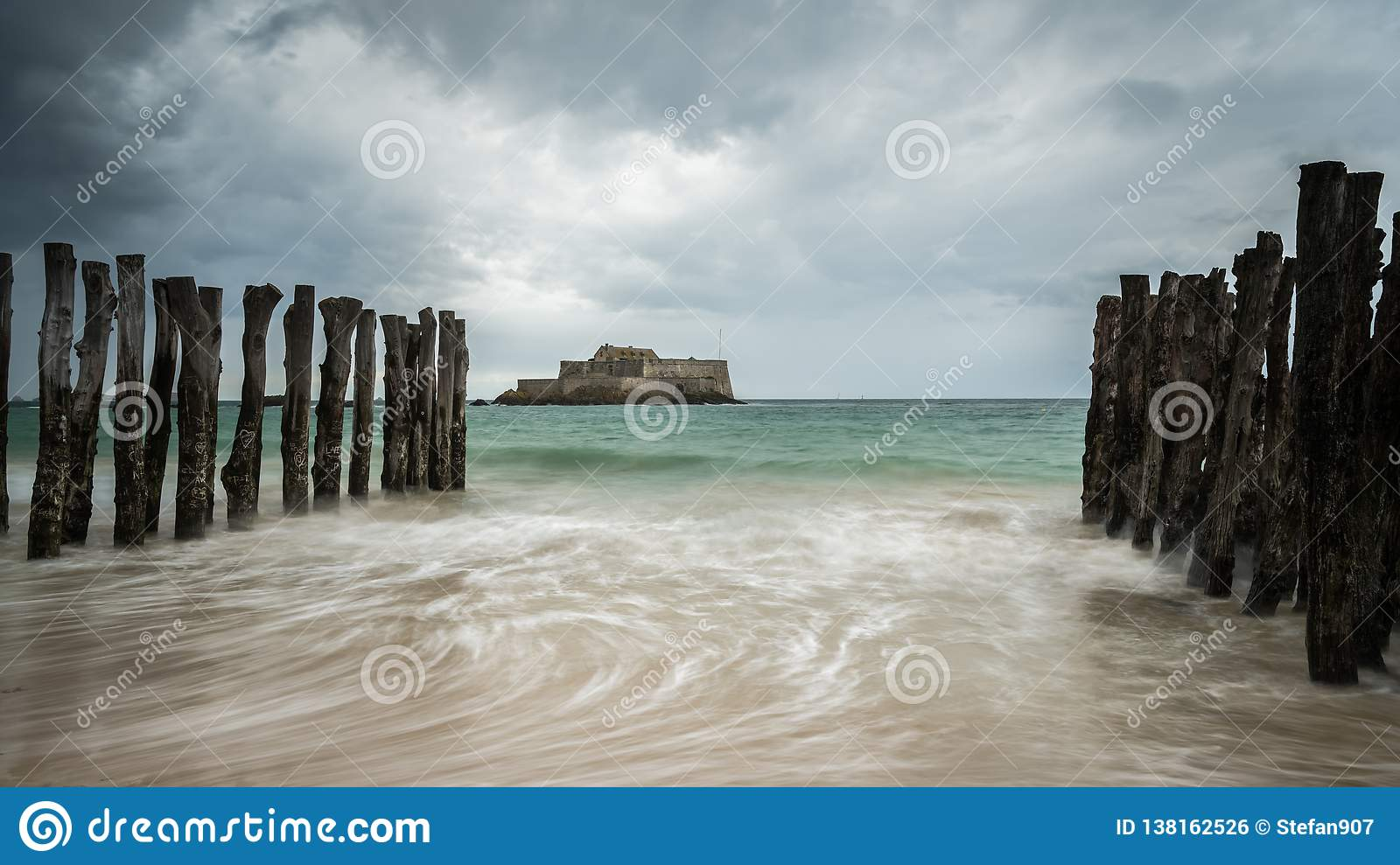 The Beach And Fort National During High Tide In Saint Malo Stock