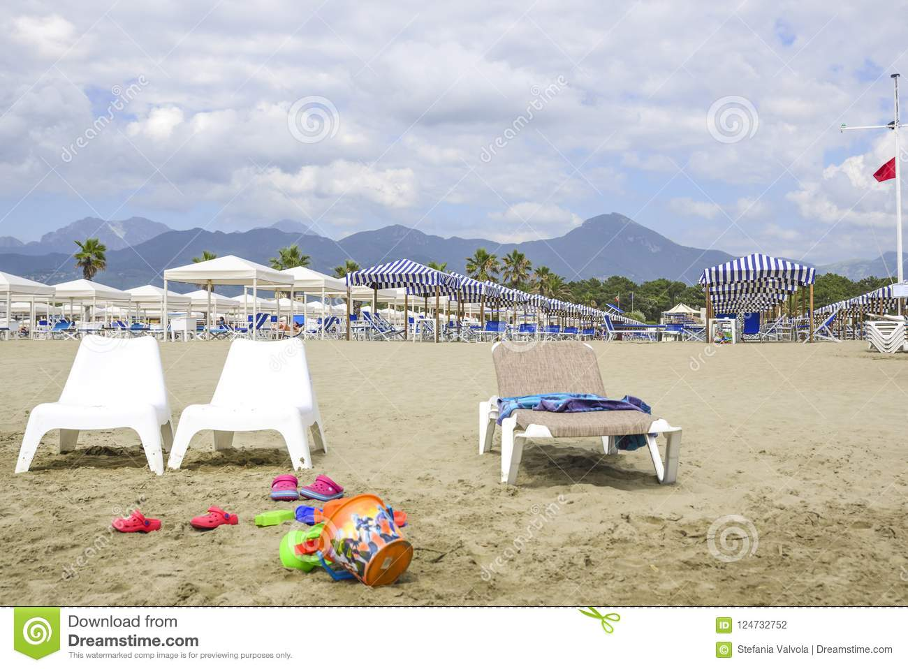 Beach with games for children in the foreground. In the background the Apuan Alps, Tuscany, Italy
