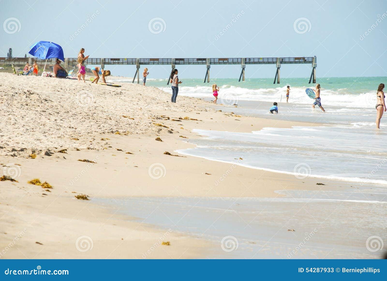 Beach Goers near Ocean Pier