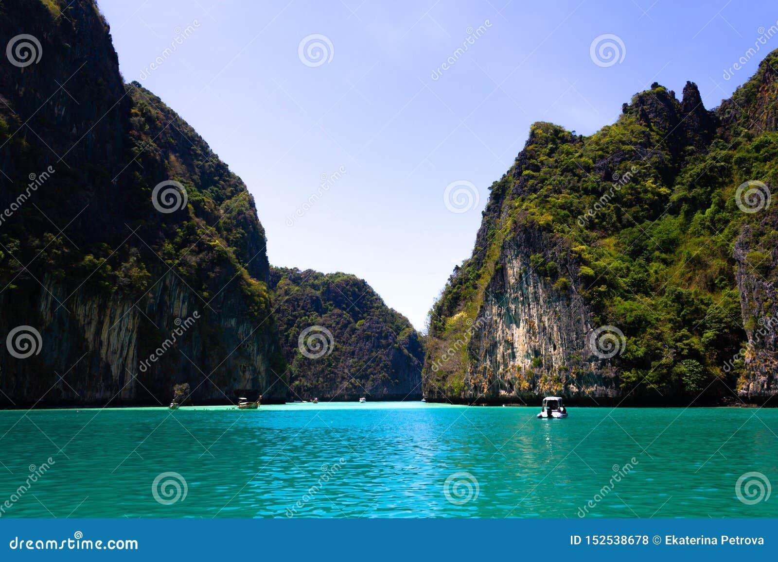 Beach in Krabi province. Vie of Maya Bay, Phi Phi island. Hong islands lagoon. Gray green stone rock on the background of crystal