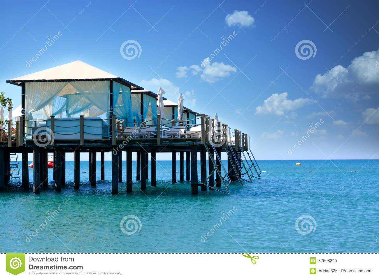 Beach landscape with sea, sky and canopy in a luxury resort