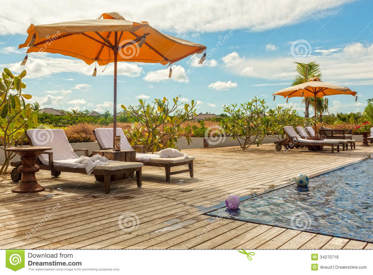 Beach Lounge Chairs With Towels Under Umbrella At The Poolside O – Lounge Chair Umbrella