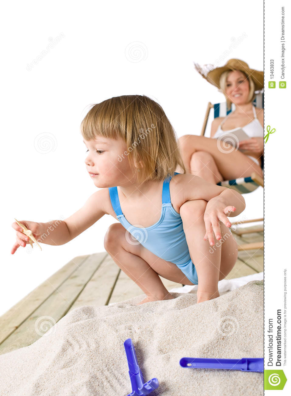 Mother With Child Play With Toys In Sand Stock