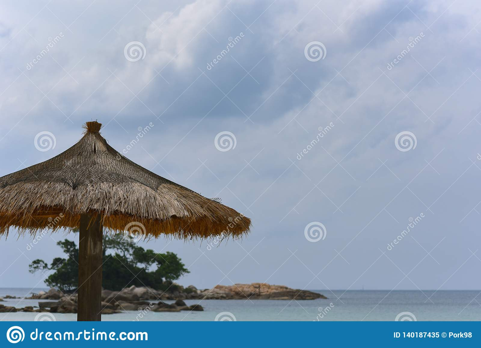 Parasol on a beach front