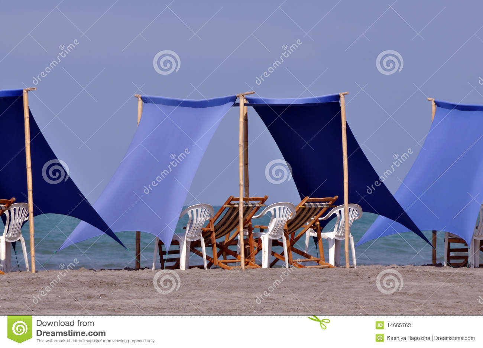 Beach recliners and canopy at beach & Beach Recliners And Canopy At Beach Stock Image - Image of twin ...