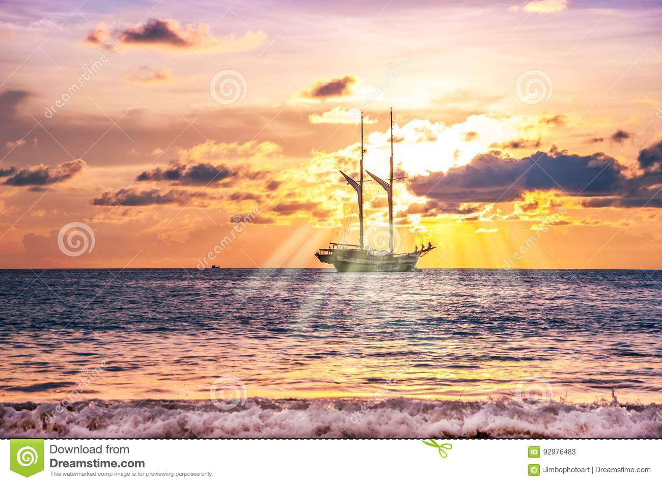 Beach sand with boat in twilight and sea sunset and sunbeam