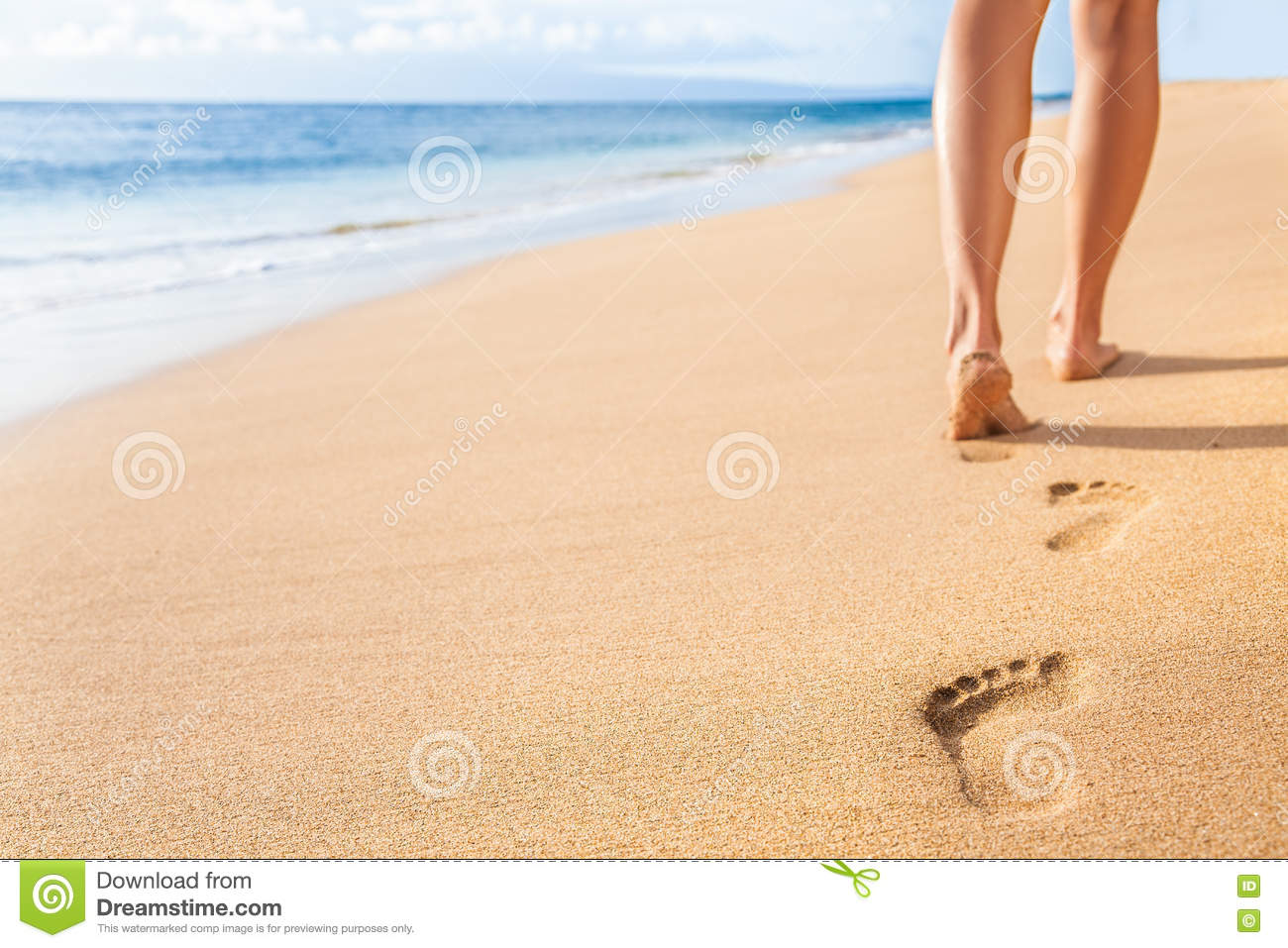 Beach sand footprints woman legs walking relaxing