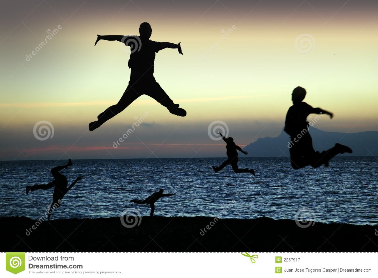 beach silhouettes jump for joy royalty free stock