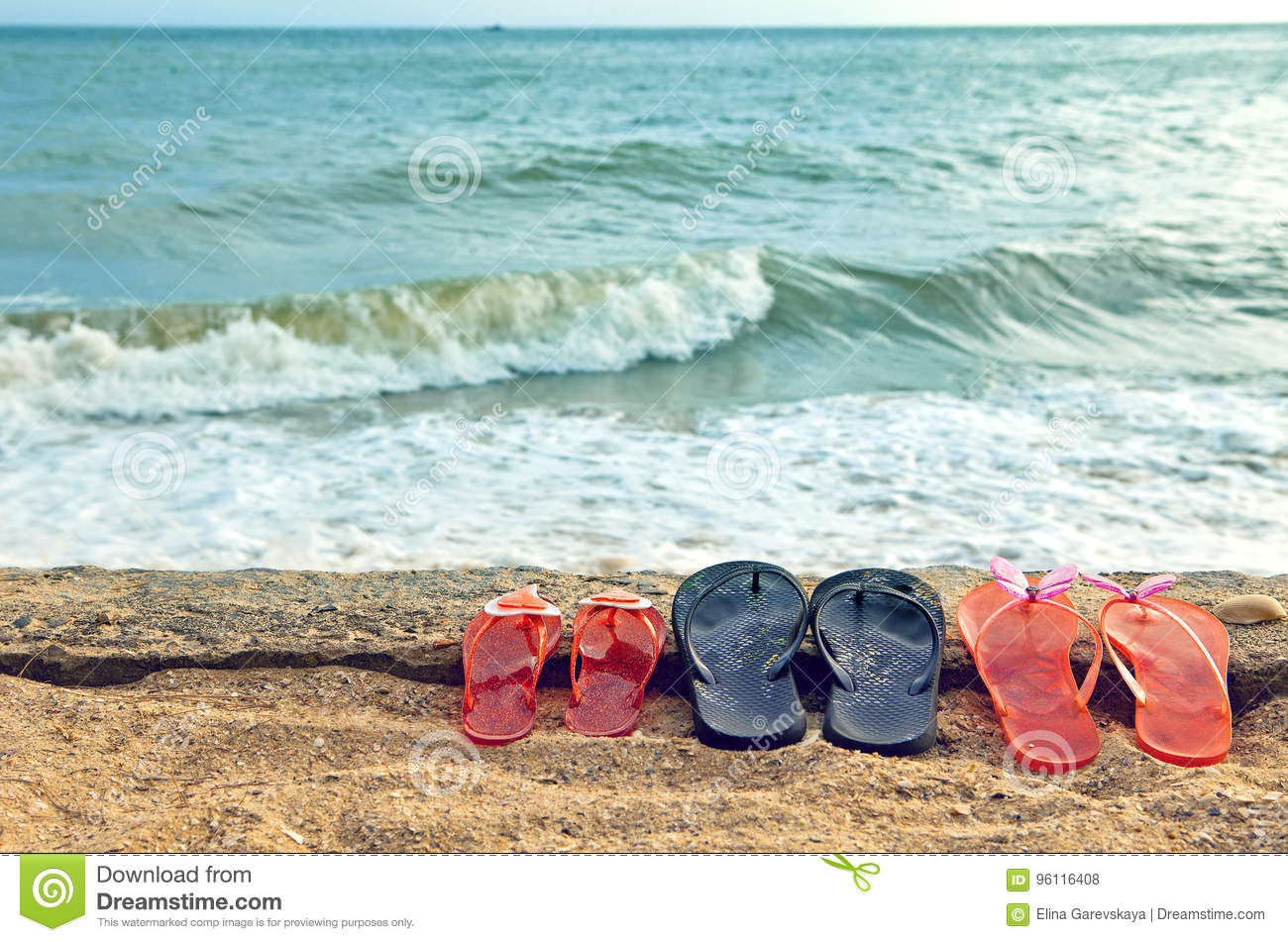 1180b254c3b6e Beach Slippers On The Sand Against The Sea Stock Photo - Image of ...