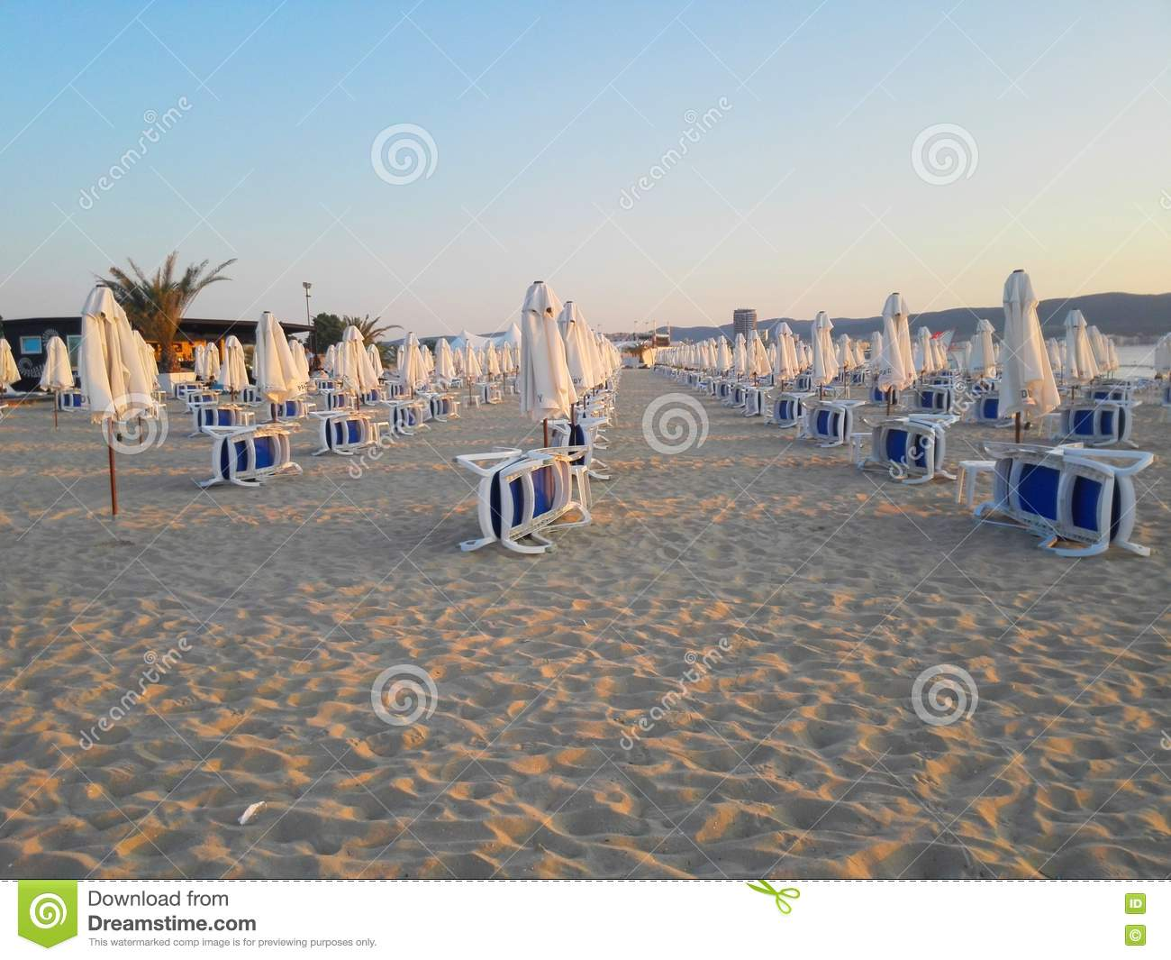 Beach chairs sunrise - Beach In Sunrise With Beach Chairs And Umbrellas Editorial Stock Image