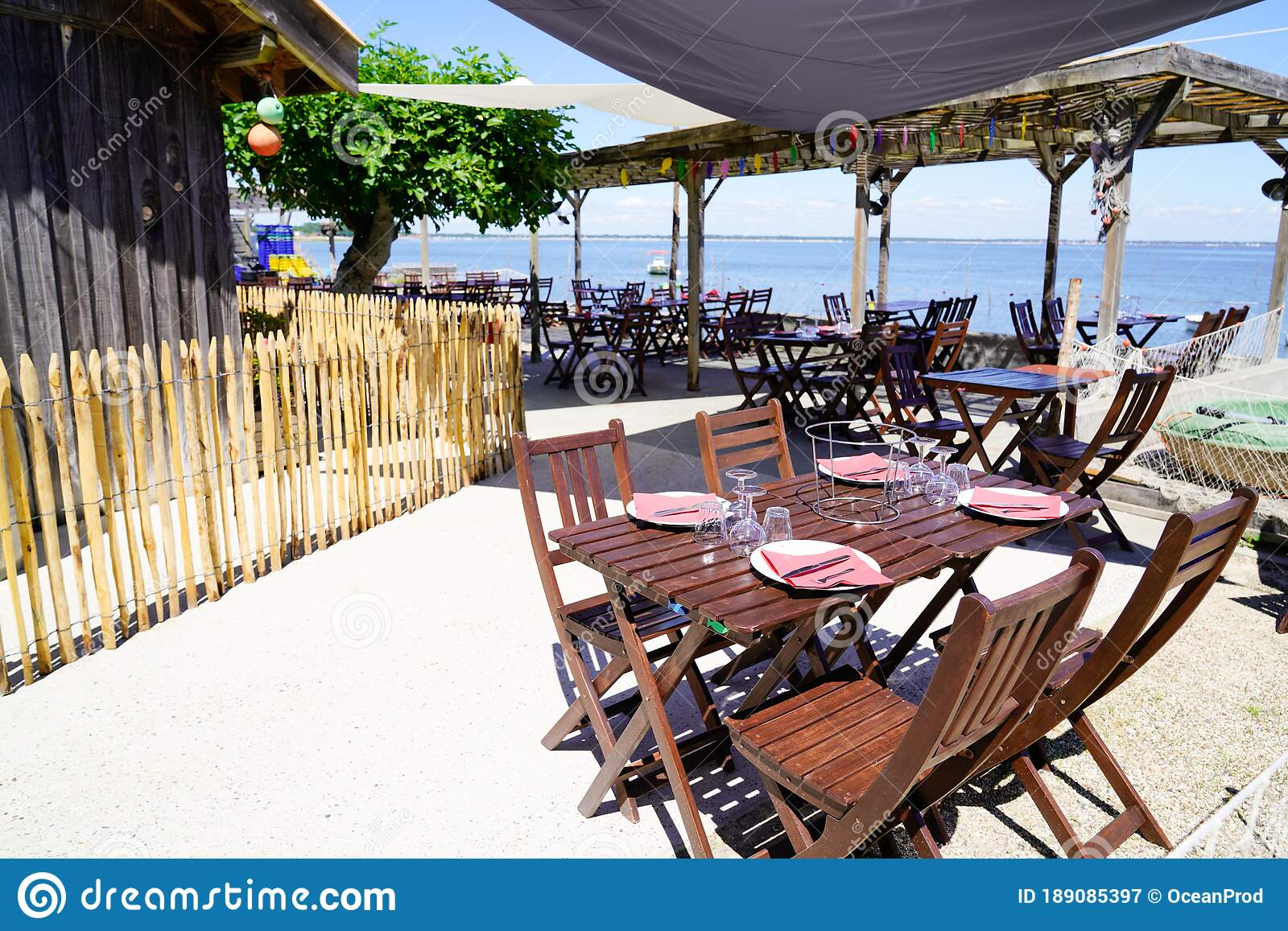 Beach Terrace Oyster Restaurant In Seaside With Empty Chairs And Wood Table On Typical Village Of L Herbe In Cap Ferret France Stock Image Image Of Holiday Edge 189085397