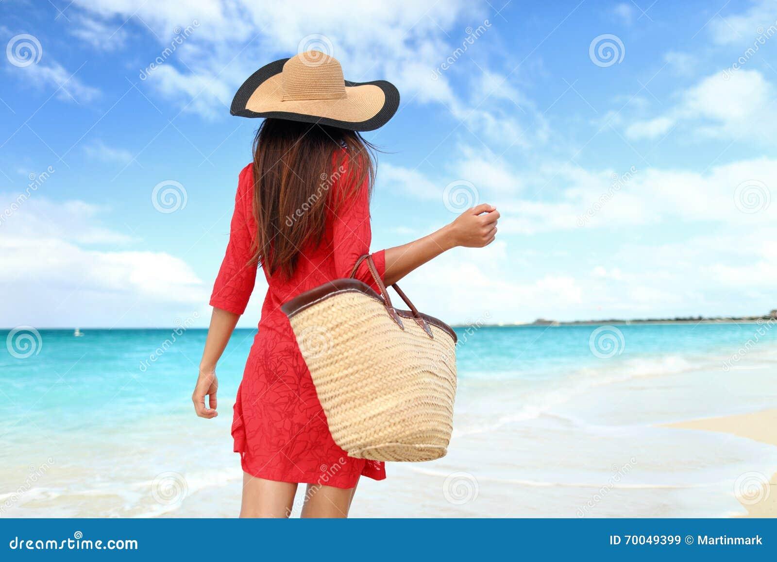 Woman tourist walking on tropical summer vacation wearing sun hat d28c8552d92