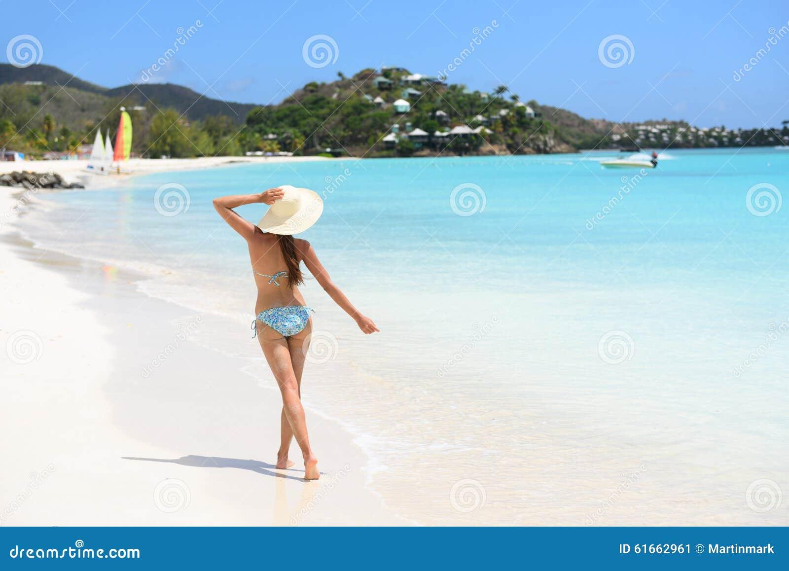 Beach Travel Woman Bikini Wearing Sun Hat Walking Stock Image ... f8decc278d5