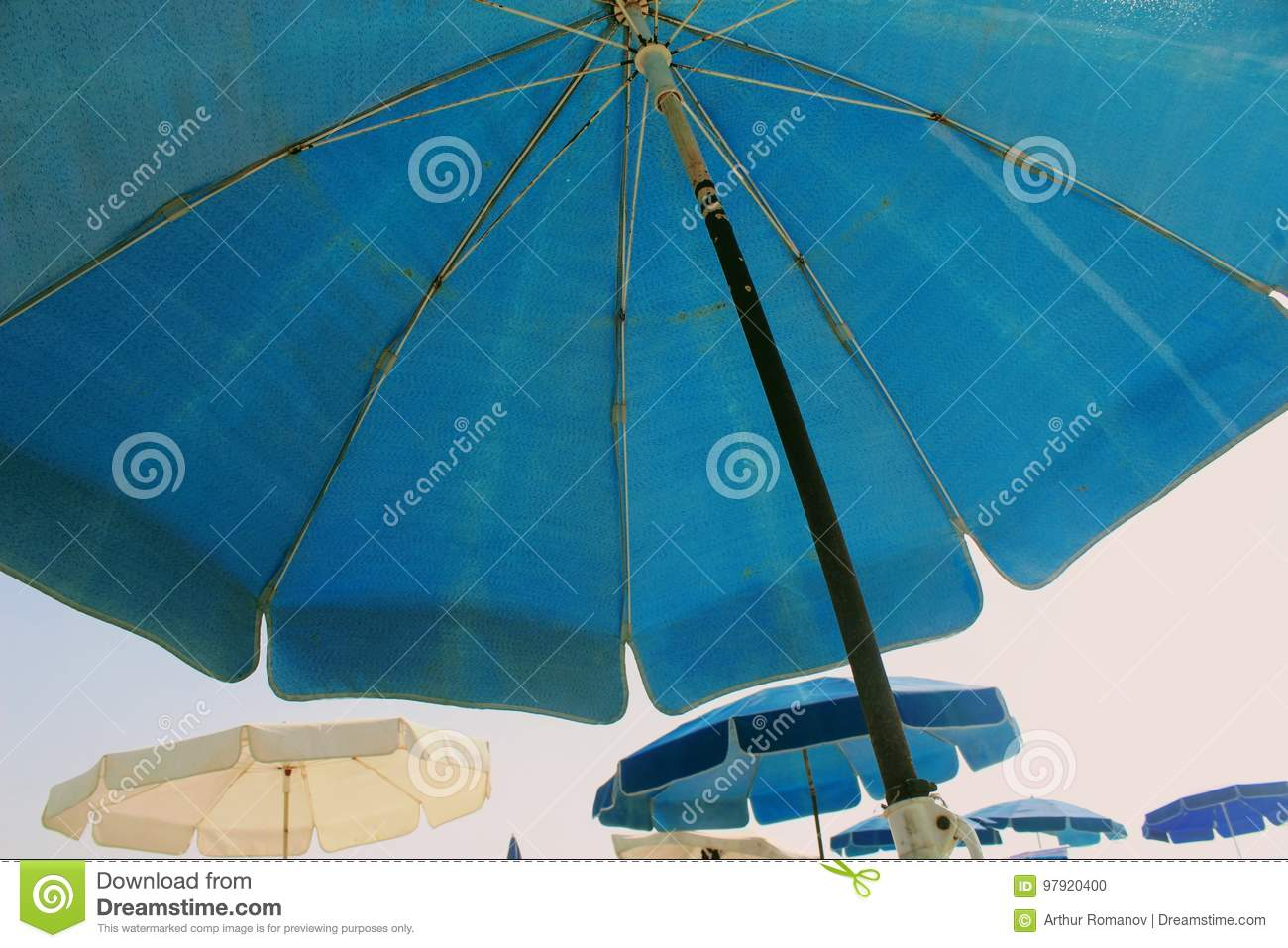 A Beach Umbrella P Ographed From Below On The Background Of Other Beach Umbrellas