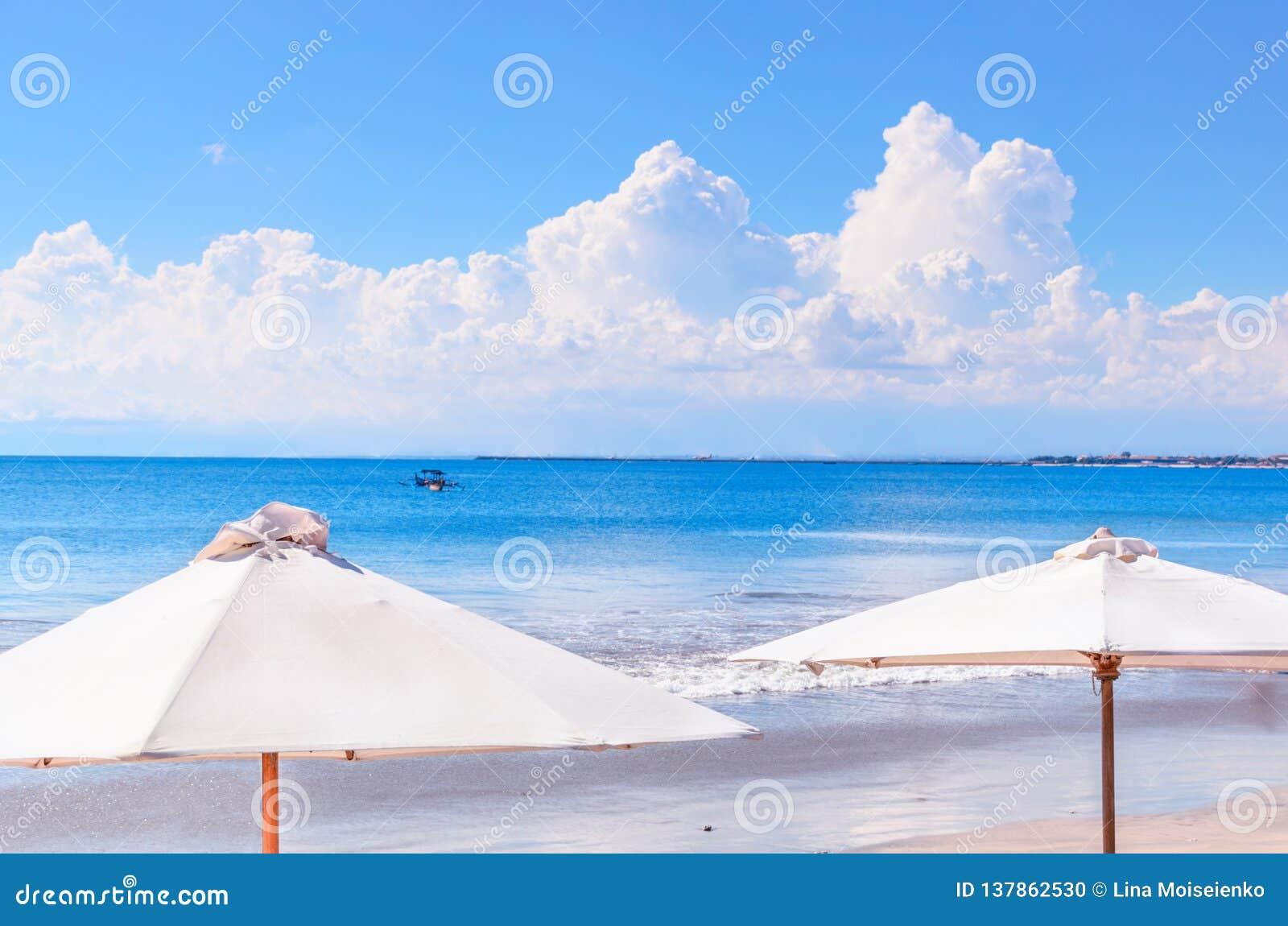 Beach Umbrellas At Calm Blue Sea Backdrop Stock Photo