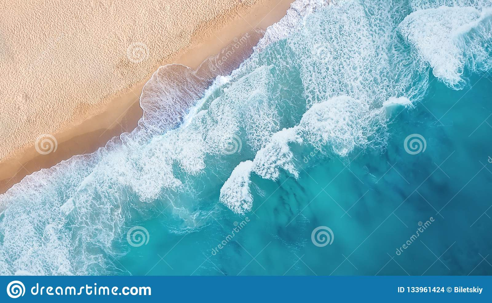 Beach and waves from top view. Turquoise water background from top view.