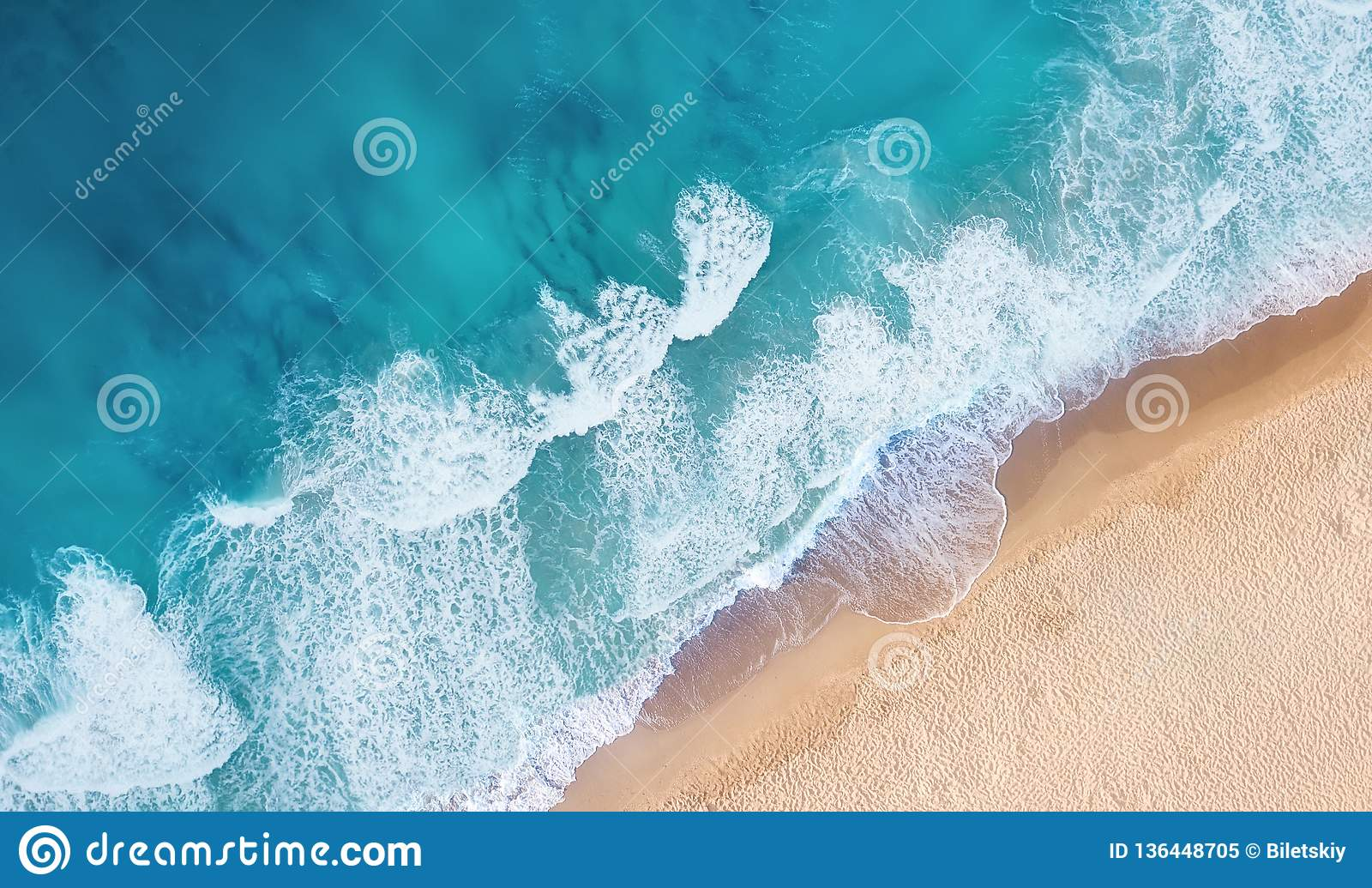 Beach and waves from top view. Turquoise water background from top view. Summer seascape from air.