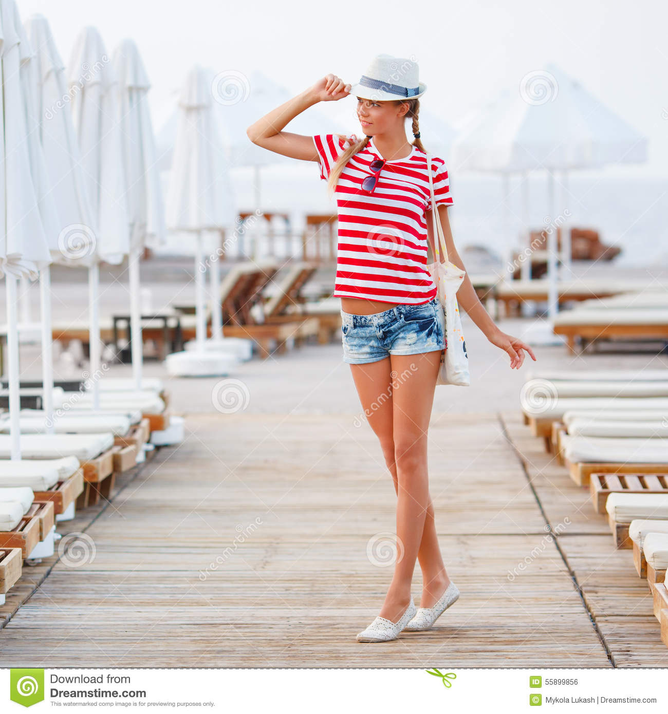 Beach woman happy and beach hat having summer fun during travel holidays vacation