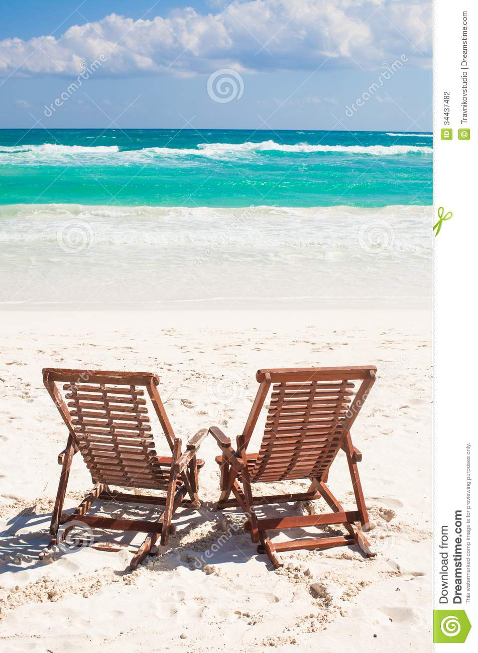 Beach wooden chairs for vacations and relax on stock photo for White sand beach vacations