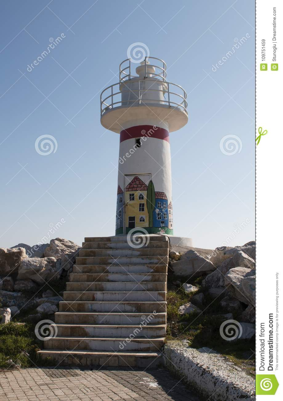 Beacon with colourful drawings and stairs