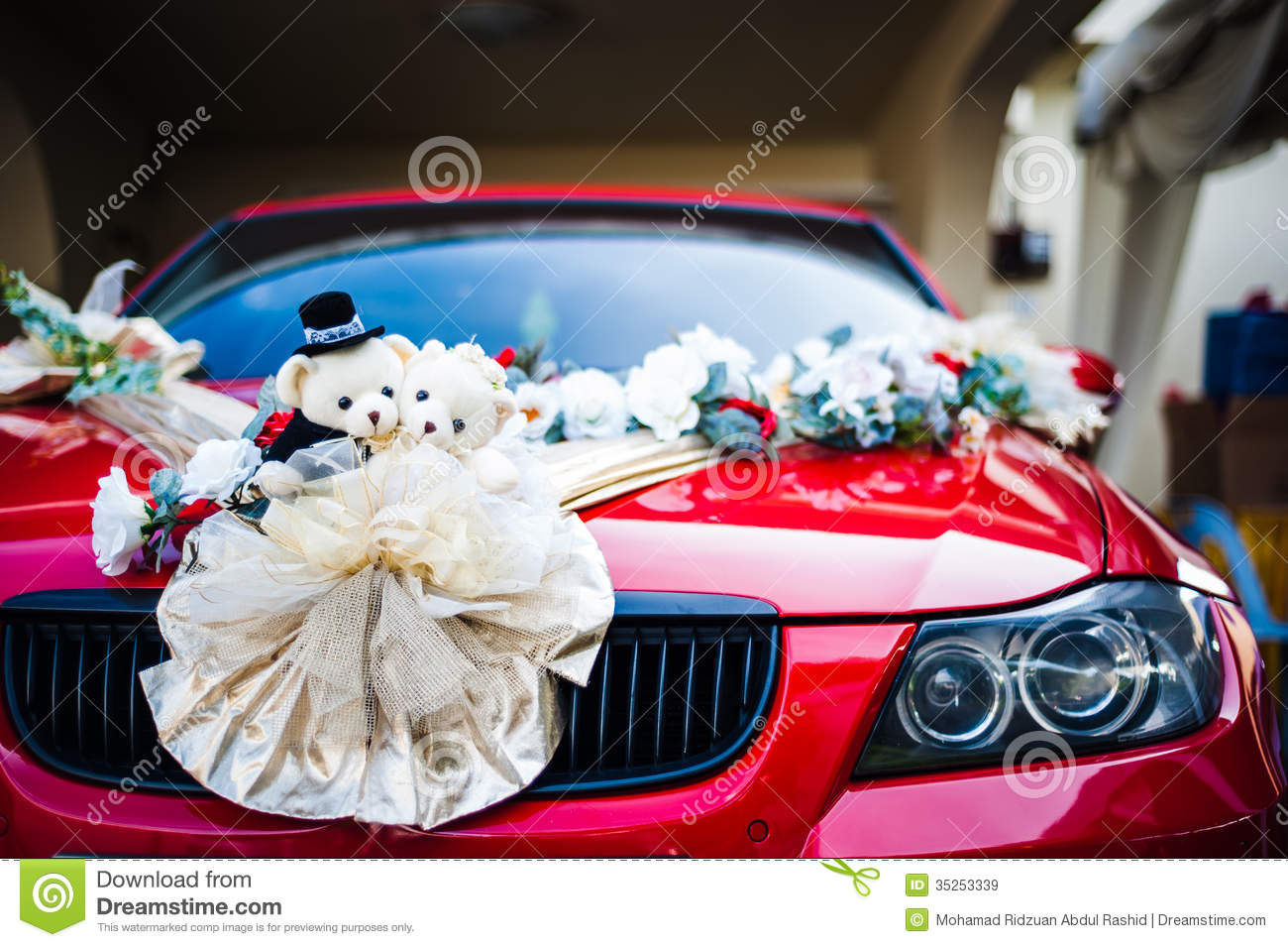 Bear Dolls And Flower Decoration On Car Stock Image