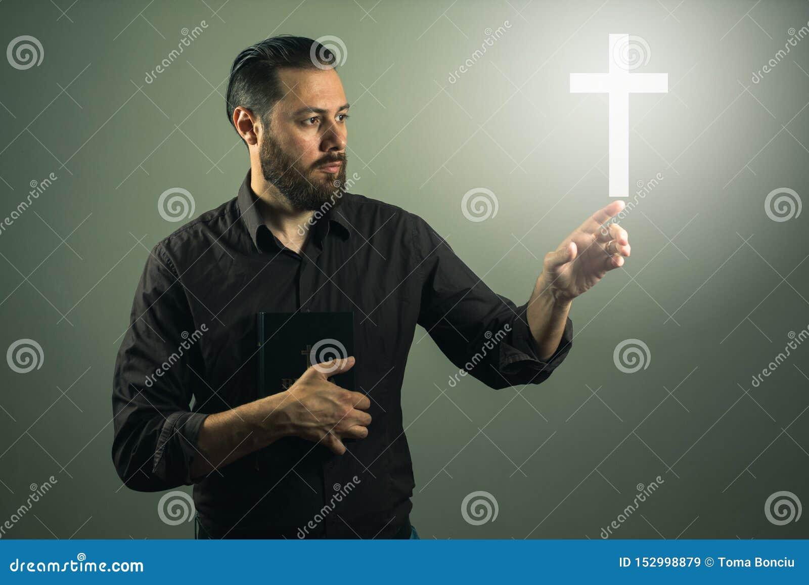 Beard handome man touchink a cross appearing in the air