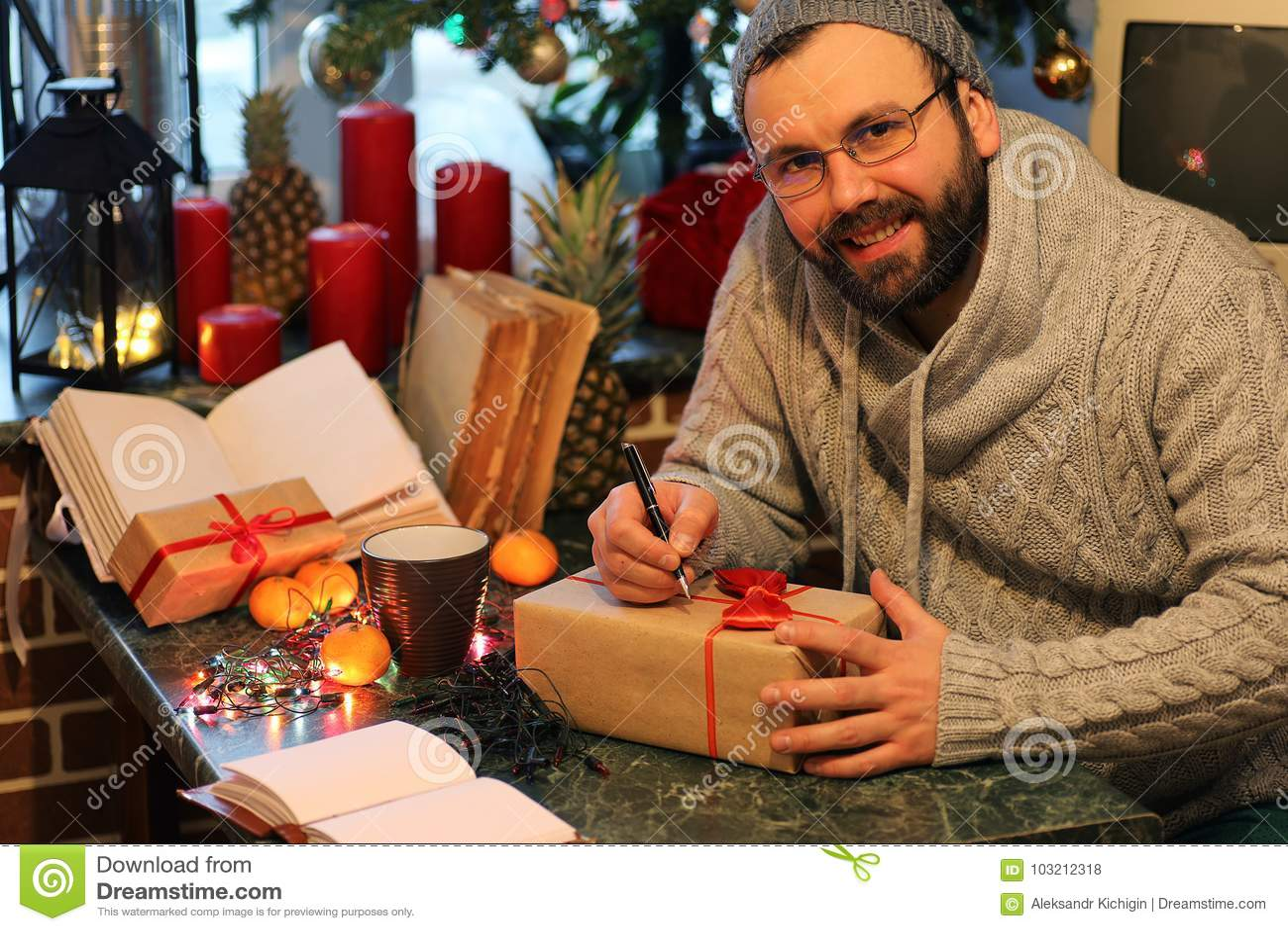 Beard Man Writing Christmas Gifts On A Table Stock Photo - Image of ...
