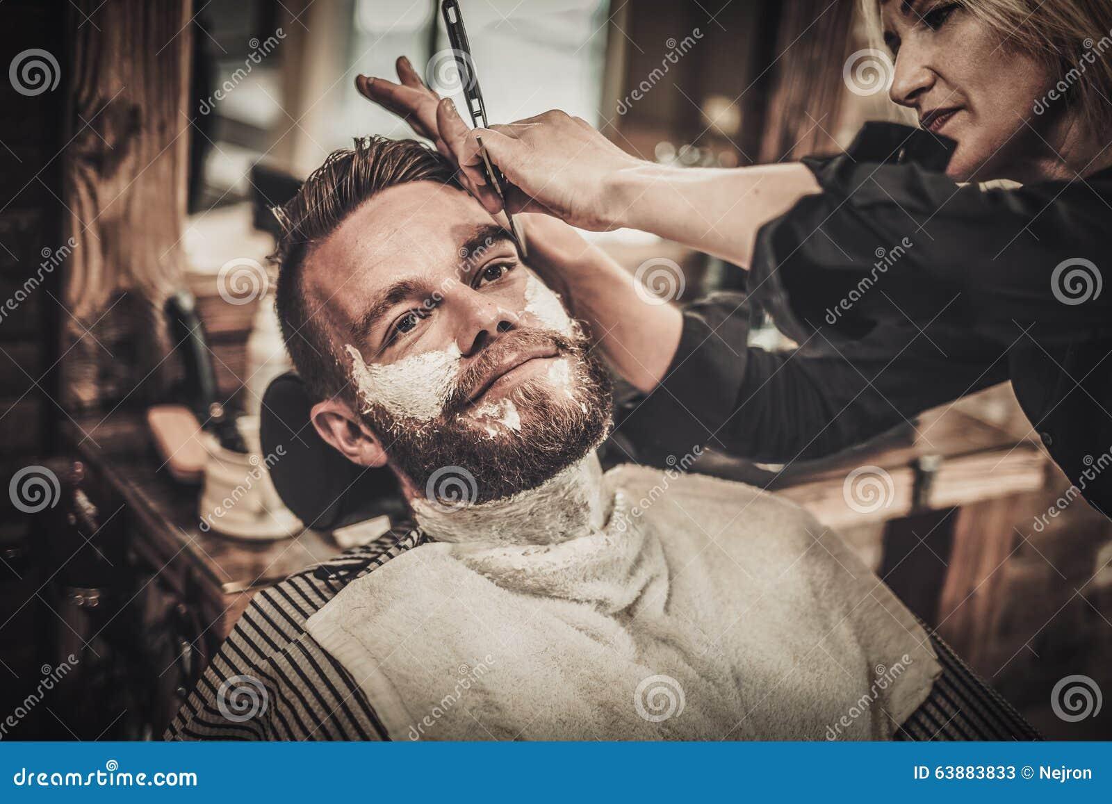 beard shaving in barber shop stock photo image 63883833. Black Bedroom Furniture Sets. Home Design Ideas