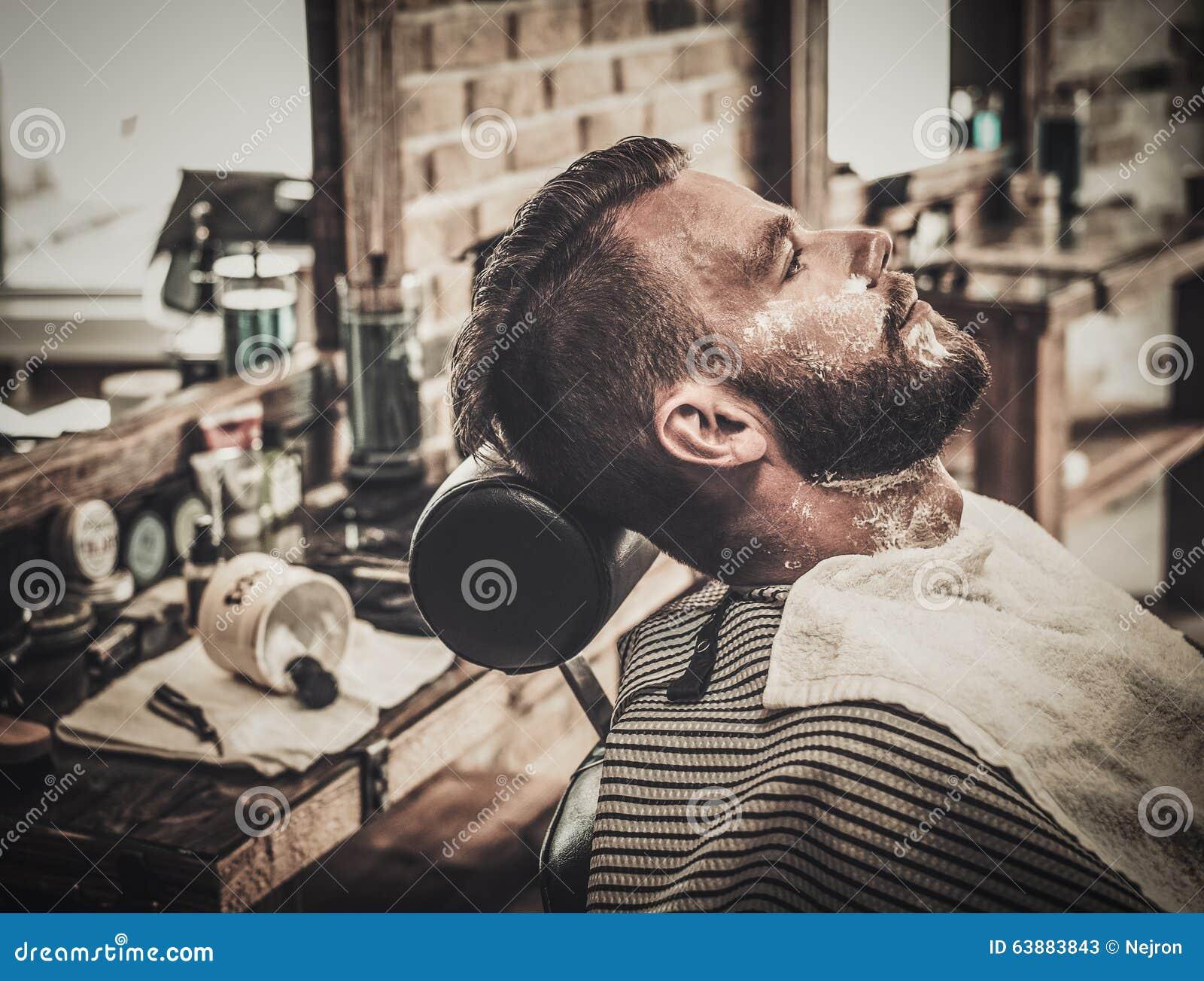 beard shaving in barber shop stock photo image 63883843. Black Bedroom Furniture Sets. Home Design Ideas