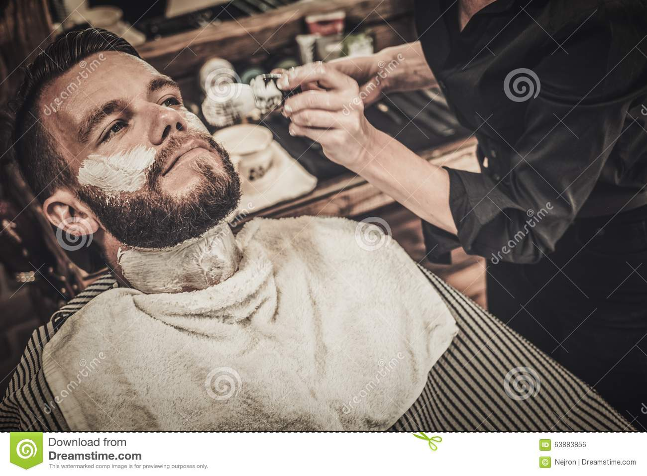 Beard Shaving In Barber Shop Royalty Free Stock