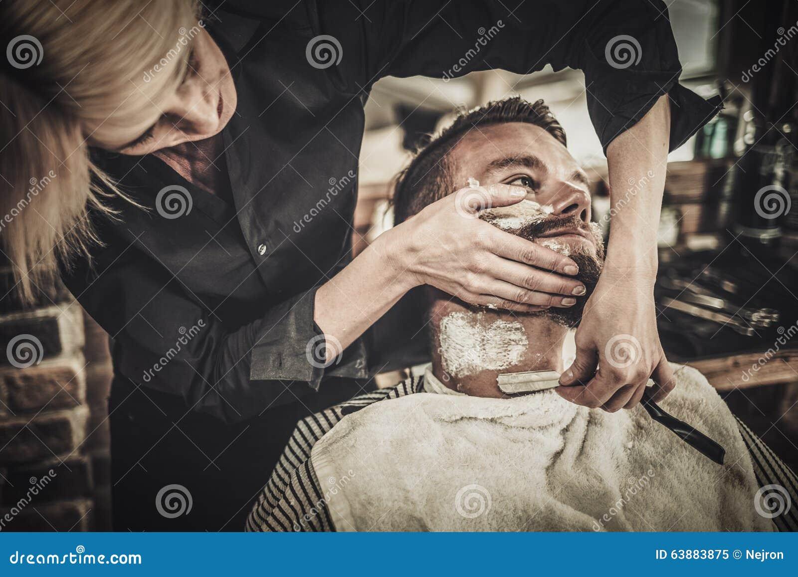 beard shaving in barber shop stock photo image 63883875. Black Bedroom Furniture Sets. Home Design Ideas