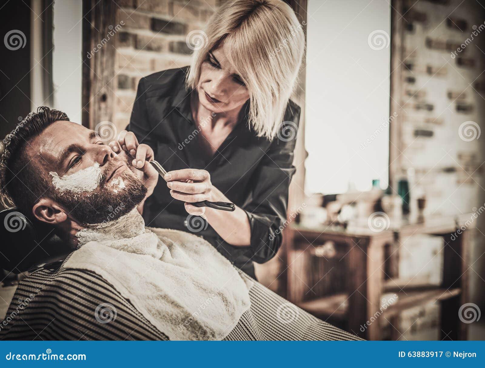 beard shaving in barber shop stock photo image 63883917. Black Bedroom Furniture Sets. Home Design Ideas