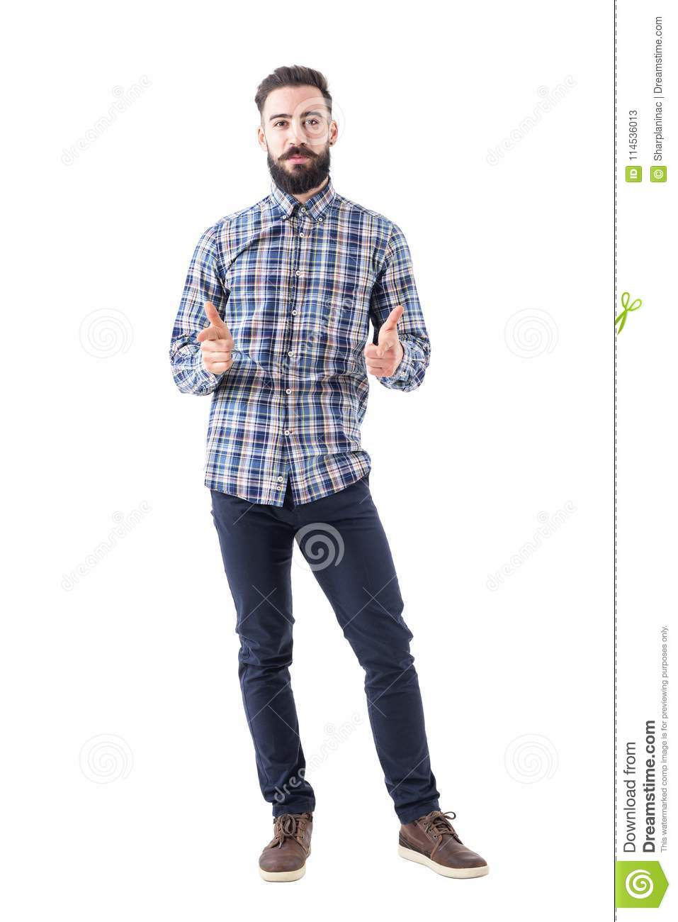 Bearded business man in plaid shirt pointing with amused expression looking at camera