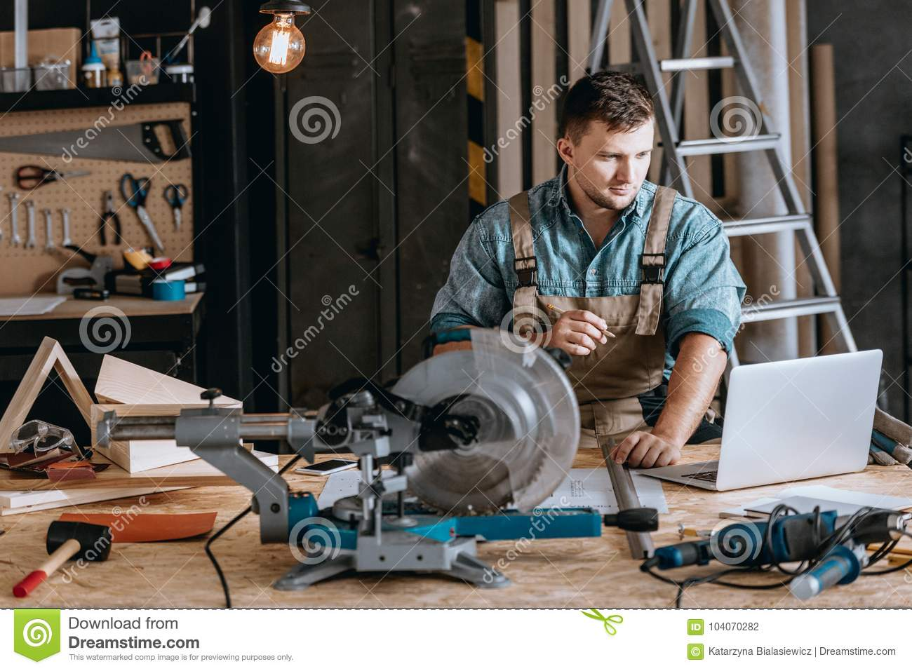 Bearded Carpenter Planning Woodworking Project Stock Photo