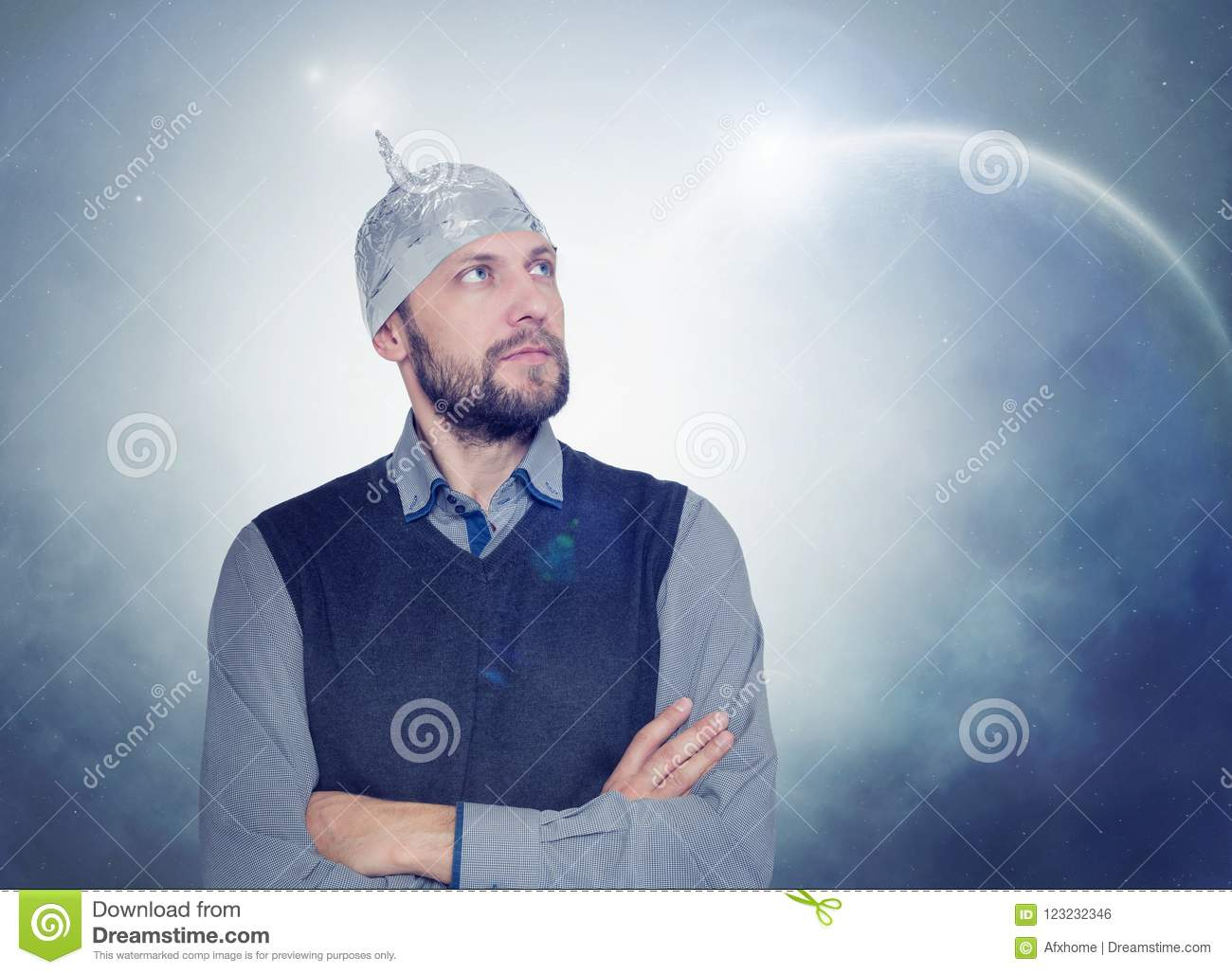 33acd5f1863 Bearded funny man in a cap of aluminum foil. Concept of cosmic fantasies.